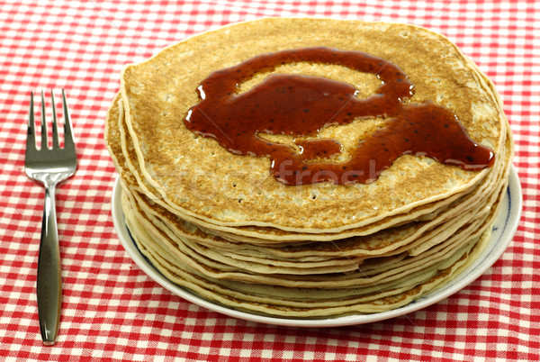 a plate with stacked freshly baked pancakes Stock photo © peter_zijlstra