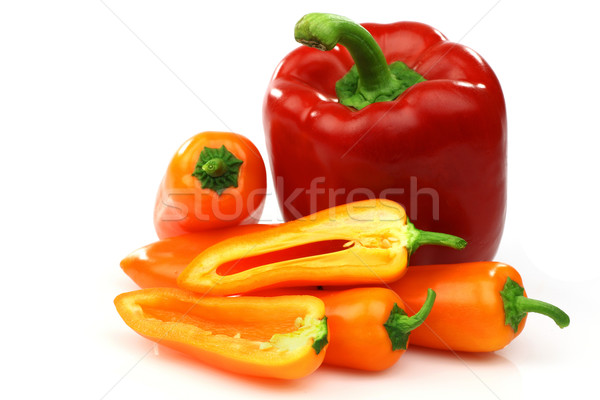 a fresh red and some orange peppers (capsicum) Stock photo © peter_zijlstra