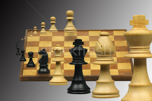 Repülés sakkfigurák sakktábla fa sakk furcsa Stock fotó © peter_zijlstra