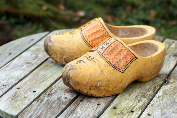 pair of traditional Dutch yellow wooden shoes Stock photo © peter_zijlstra