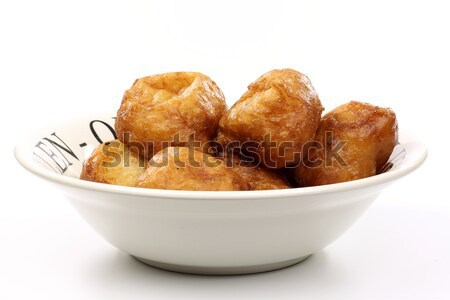 freshly baked traditional dutch oliebollen in a white ceramic bowl Stock photo © peter_zijlstra