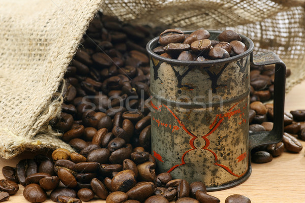 measuring cup  and a burlap bag with coffee beans  Stock photo © peter_zijlstra