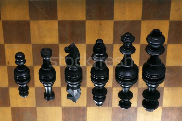 Fekete sakkfigurák kockás sport tükör gondolkodik Stock fotó © peter_zijlstra