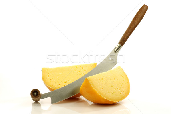 pieces of Dutch Edam cheese with a cheese cutter Stock photo © peter_zijlstra