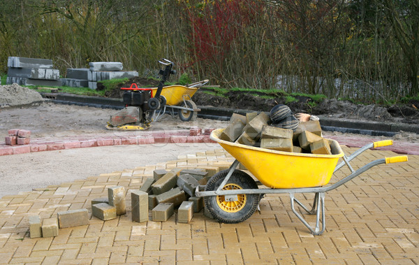 yellow wheelbarrow on a road Stock photo © peter_zijlstra