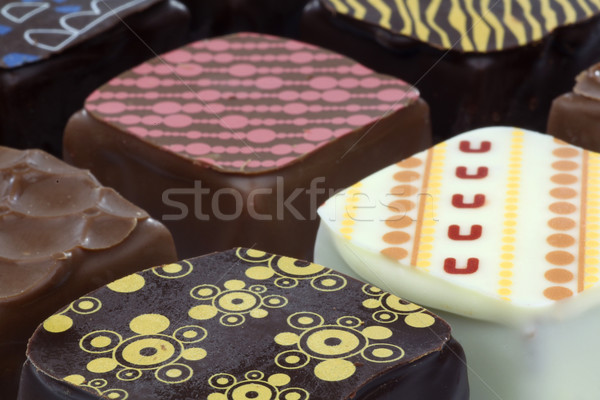 Luxus csokoládé díszített étel csoport minta Stock fotó © peter_zijlstra