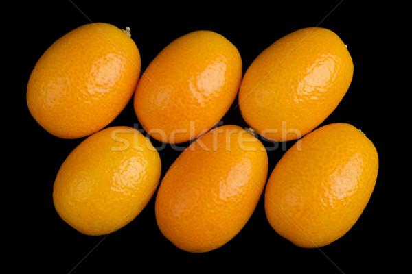 Oblique Oval Kumquats On Black Background Stock photo © PeterHermesFurian