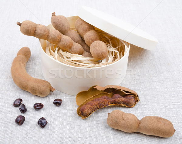 Dried Tamarind Fruits With Seeds In A Box On Linen Stock photo © PeterHermesFurian