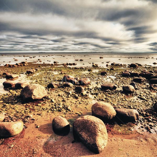 Nagy kövek sötét felhős égbolt víz Stock fotó © PetrMalyshev