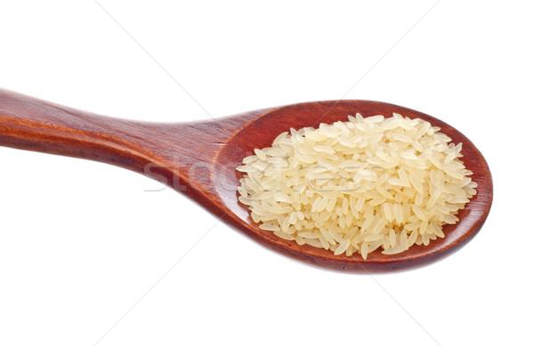 Blanco arroz cuchara de madera aislado alimentos naturaleza Foto stock © PetrMalyshev