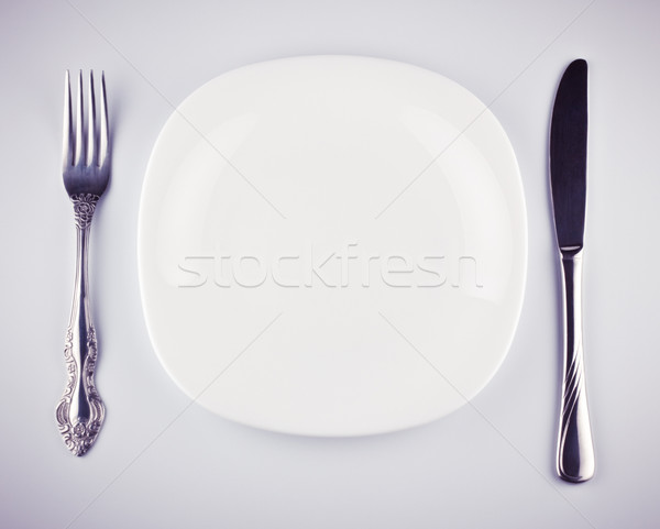 empty white dish knife and fork Stock photo © PetrMalyshev