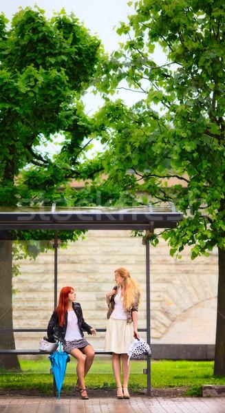 Iki kızlar otobüs durağı yağmurlu gün ağaç Stok fotoğraf © PetrMalyshev