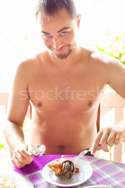 Man Eating Crab Stock photo © PetrMalyshev