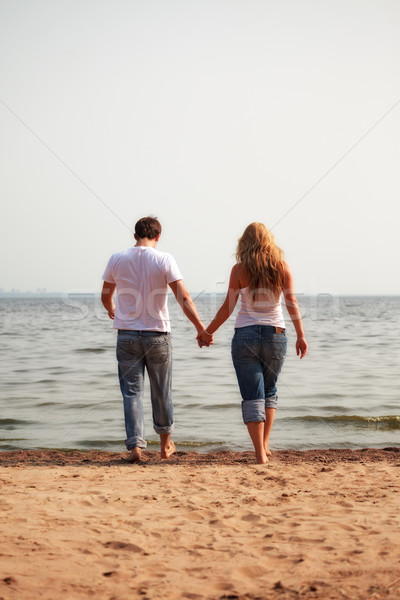 Couple marche plage homme océan Photo stock © PetrMalyshev