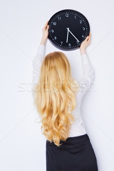 Office Girl Sets the Clock Stock photo © PetrMalyshev