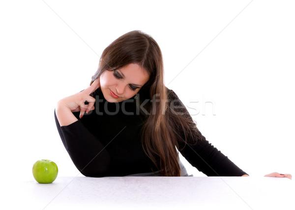 Meisje staren appel groene geïsoleerd witte Stockfoto © PetrMalyshev
