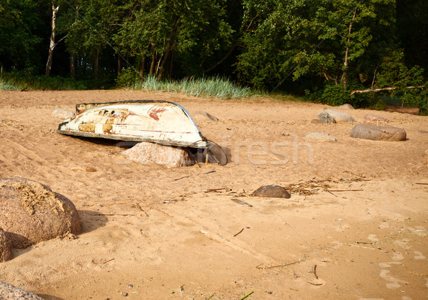 Beach With Old Boat Stock photo © PetrMalyshev