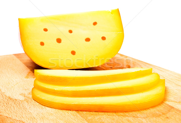 Stock photo: cheese slices on cutting board