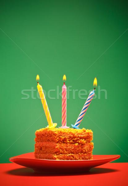 Bolo de aniversário vela rosa fogo feliz chocolate Foto stock © PetrMalyshev