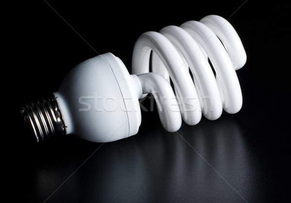 Zwarty fluorescencyjny żarówka odizolowany czarny lampy Zdjęcia stock © PetrMalyshev
