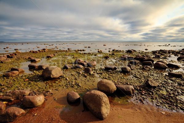 Nagy kövek sötét felhős égbolt naplemente Stock fotó © PetrMalyshev