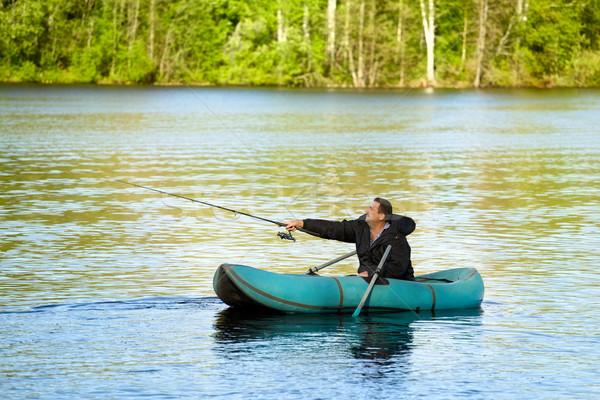 Fisherman in Rubber Boat Stock photo © PetrMalyshev