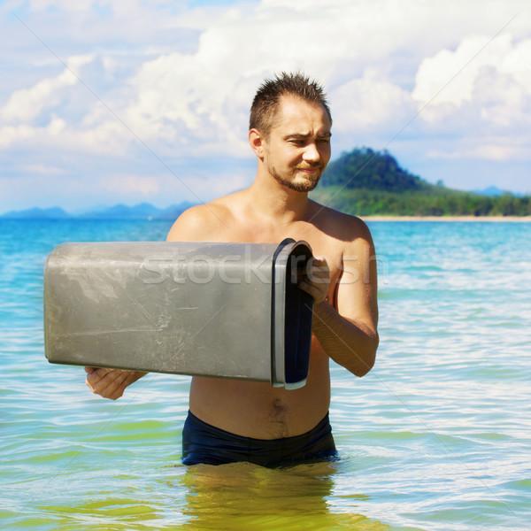 Man with Trashcan Stock photo © PetrMalyshev