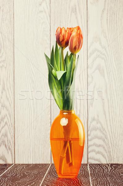Tulipano fiori bouquet vaso legno primavera Foto d'archivio © PetrMalyshev