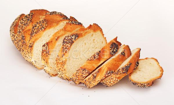 Szeletel fehér kenyér pipacs háttér asztal kenyér Stock fotó © PetrMalyshev