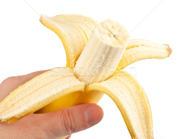 Pelé banane main blanche fond fruits Photo stock © PetrMalyshev