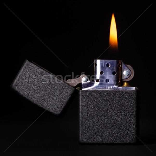 Brucia accendino nero benzina fiamma buio Foto d'archivio © PetrMalyshev