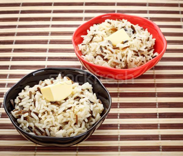 Bol cuit riz deux bols beurre Photo stock © PetrMalyshev