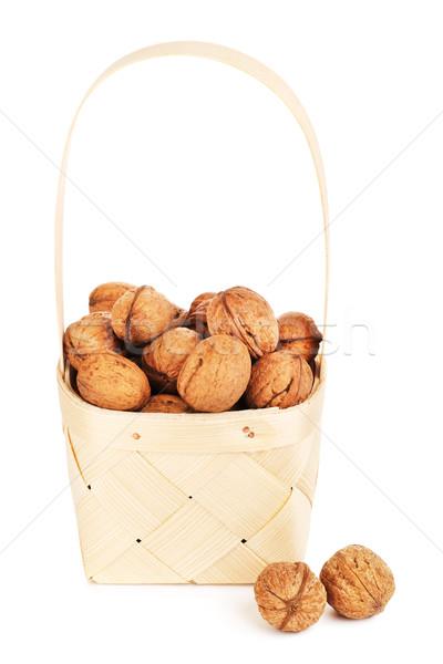 Walnut In Wooden Basket Stock photo © PetrMalyshev