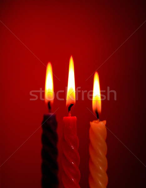 Stock photo: Three Candles On Red