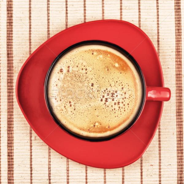 Rouge tasse de café rayé nappe haut vue Photo stock © PetrMalyshev