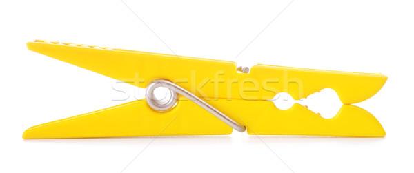 Amarelo prendedor de roupa plástico isolado branco casa Foto stock © PetrMalyshev