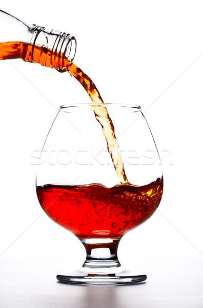 Cognac verre blanche fond Photo stock © PetrMalyshev