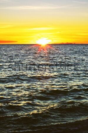 Belo pôr do sol mar água paisagem fundo Foto stock © PetrMalyshev