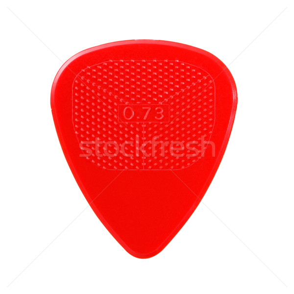 red ribbed guitar plectrum isolated on white Stock photo © PetrMalyshev