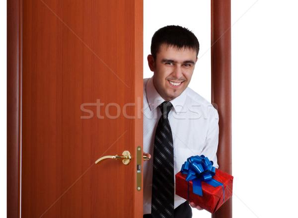 smiling man with gift Stock photo © PetrMalyshev