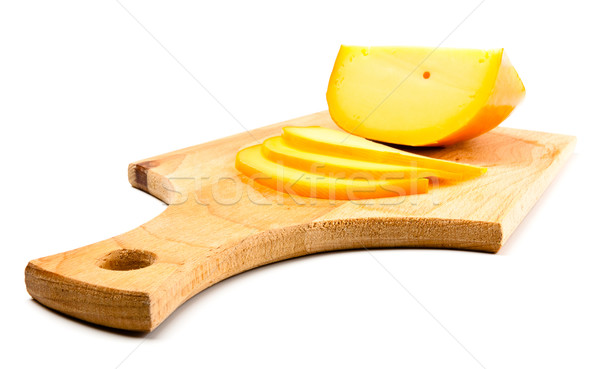 cheese slices on cutting board Stock photo © PetrMalyshev