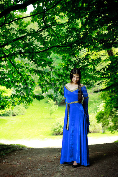 beautiful princess in shadow of big trees Stock photo © PetrMalyshev