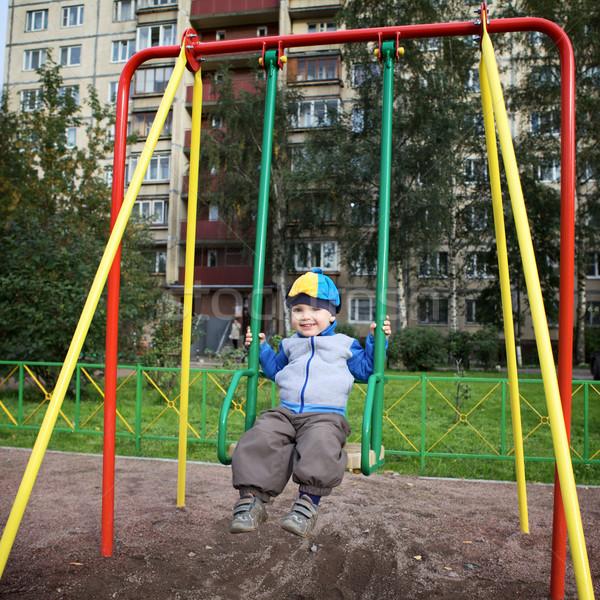 Boy Playing on Playground Stock photo © PetrMalyshev