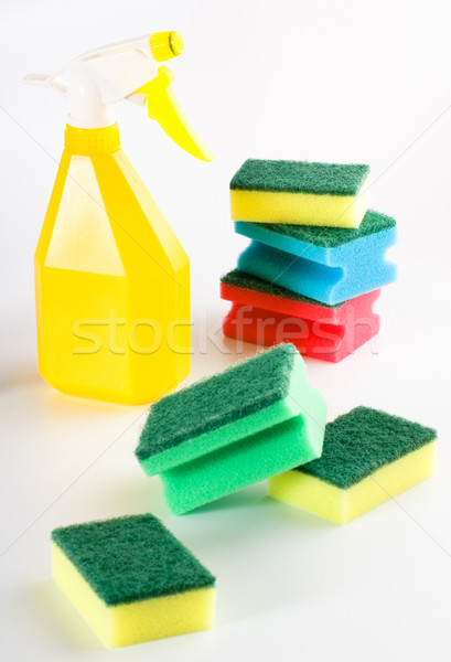 yellow spray bottle and multicolored sponges Stock photo © PetrMalyshev