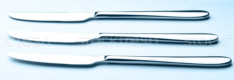 three table knives Stock photo © PetrMalyshev
