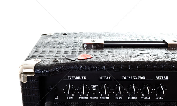 two plectrums on guitar amplifier Stock photo © PetrMalyshev