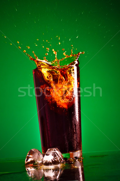 Splashing Cola Stock photo © PetrMalyshev