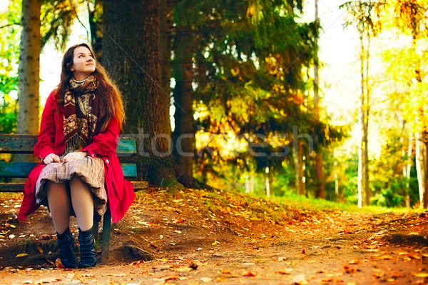 Young elegant woman  sitting on bench Stock photo © PetrMalyshev
