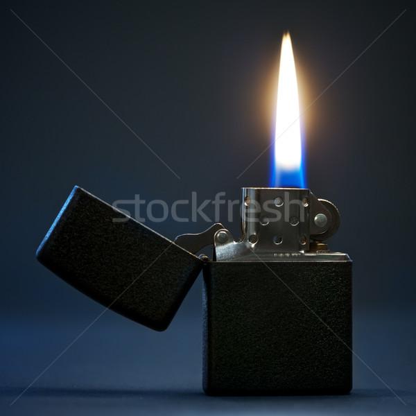 Ardente isqueiro preto gasolina chama escuro Foto stock © PetrMalyshev
