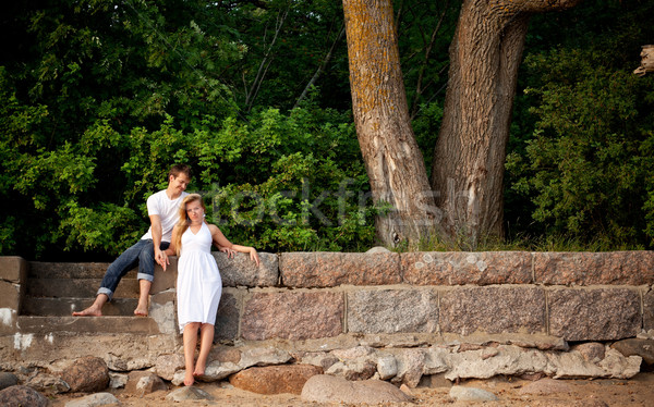 couple stand next stonewall in forest Stock photo © PetrMalyshev